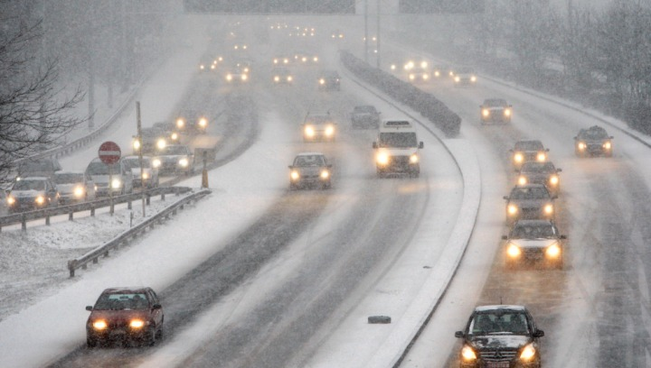 Cars drive on snow covered highways near Brussels